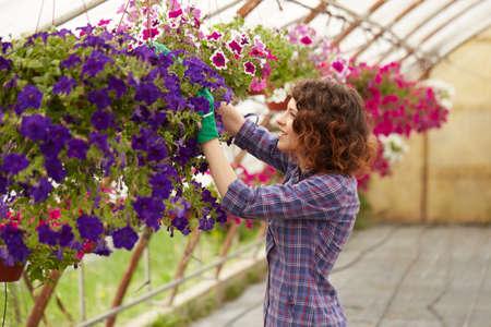 Attractive cute woman gardener