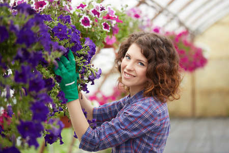 Attractive cute woman gardener
