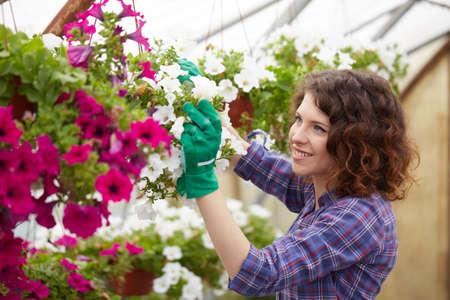 conservatory: Attractive cute woman gardener