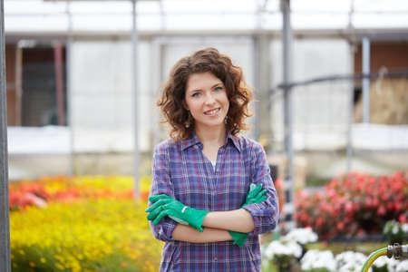 pretty female gardener in greenhouse Stock Photo