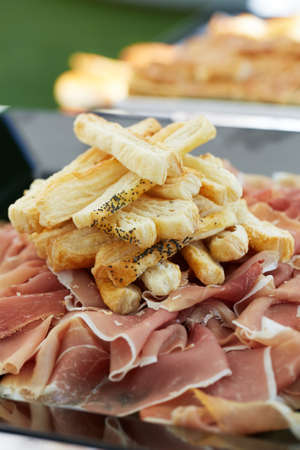 cured ham: Prosciutto, traditional italian cured ham with slices of bread