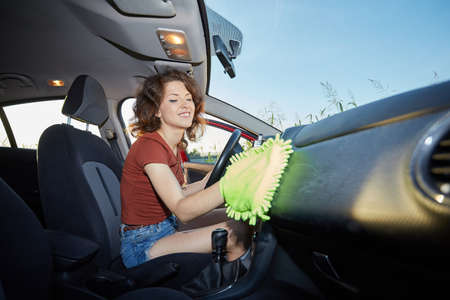 microfiber cloth: woman with microfiber cloth cleaning car