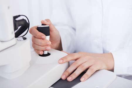 sighted: Optometrist performing visual field test