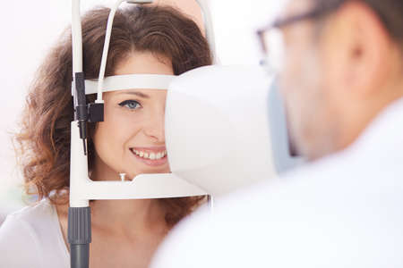 far sighted: Optometrist doing sight testing for patient