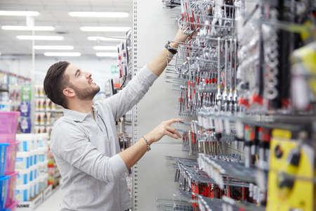 retailer: man customer in hardware store