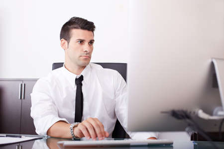 severity: young businessman working