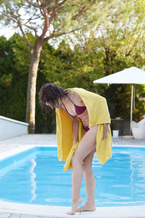 wiping: Beautiful sexy woman wiping legs with towel after swimming pool