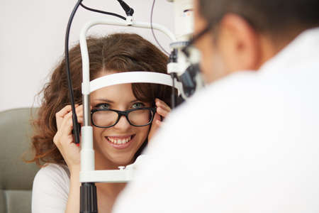 young woman take care of her eyes Stock Photo