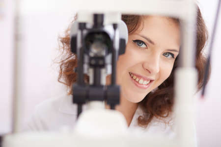 anesthetize: young female optometrist working