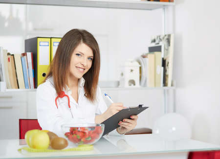 dietetics: young nutritionist Stock Photo