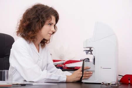 anesthetize: optometrist working Stock Photo