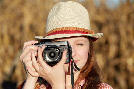 Young traveling woman in country taking photos Stock Photo