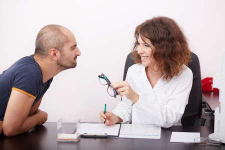 optometrist: Optometrist in exam room