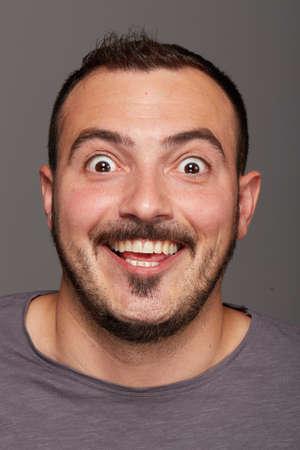 unintelligent: man doing a funny facial expression