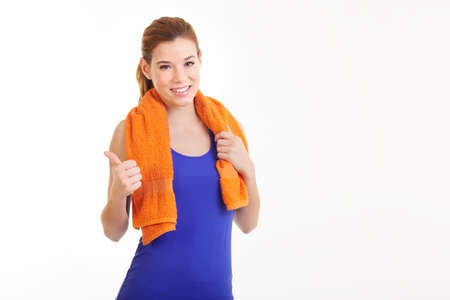 Portrait of cheerful pretty young fitness woman with white towel on her neck