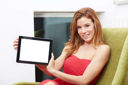 Smiling beautiful young woman showing blank no-name tablet pc monitor