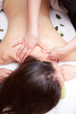 beauty, holidays and spa concept - woman in spa salon getting massage photo