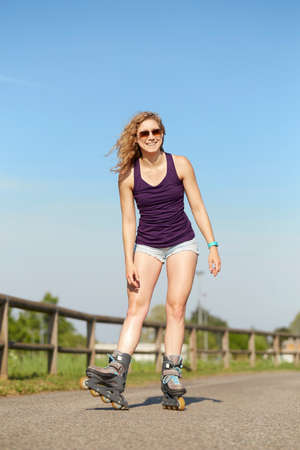 roller blade: Skating woman on blades in park. Stock Photo