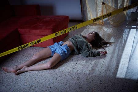 coroner: Crime scene imitation. Lifeless woman lying on the floor