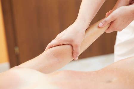Getting a Salt Scrub Beauty Treatment in the Health Spa Stock Photo