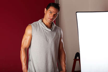 professionally: Young beautiful male model posing in professionally equipped studio Stock Photo