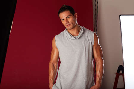 Young beautiful male model posing in professionally equipped studio Stock Photo