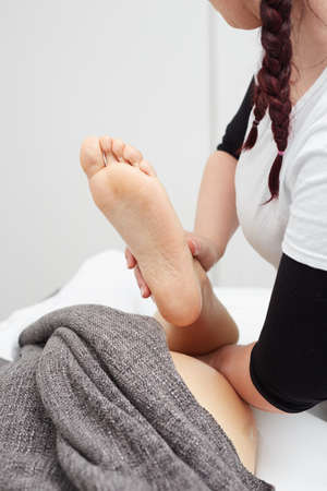 Female Enjoying Relaxing Back Massage In Cosmetology Spa Centre Stock Photo