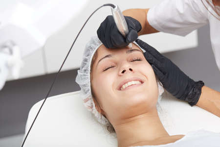 professional tattooist making permanent make-up Stock Photo