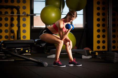 beautiful athletic woman working IN GYM Archivio Fotografico