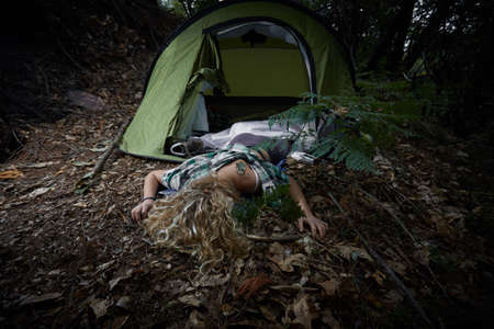young woman lying dead in a forest after rape