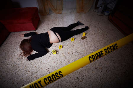 young woman lying dead  after rape Imagens
