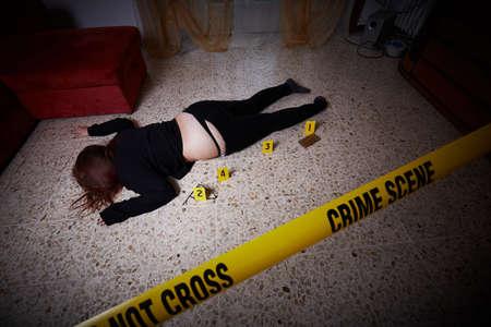 young woman lying dead  after rape Фото со стока