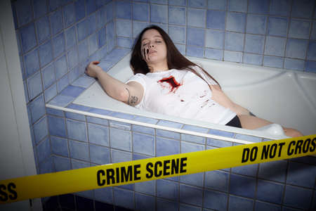 young woman lying dead in a bath tub Stock Photo - 87527852