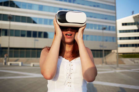 young woman using viewer for augmented reality