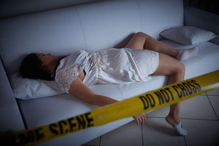 crime scene - woman liyng dead on the sofa