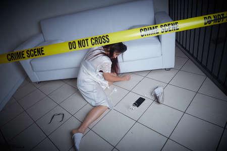 crime scene - woman liyng dead on the sofa