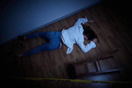 crime scene - woman lying dead on the floor
