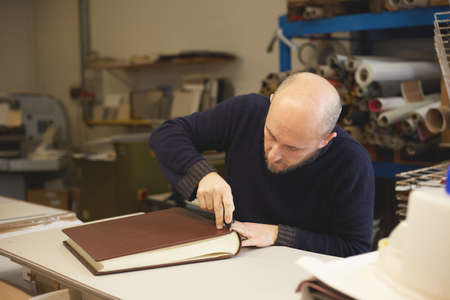 book binder make a leather cover