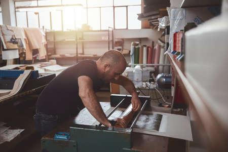 book binder working in a warehouse