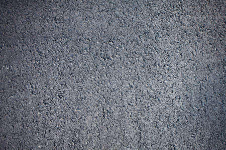 Top close-up horizontal view of new clean asphalt road with vignette photo