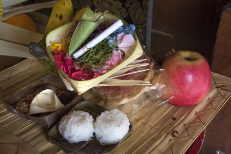 gods: Offerings to gods in Bali with flowers, fruit, rice, cigarette