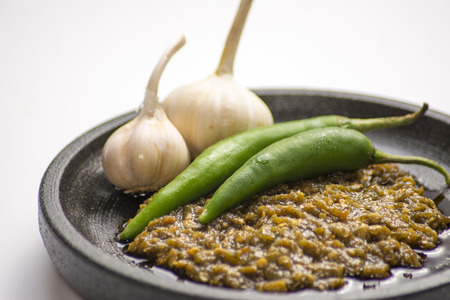 sambal: Sambal hijau, traditional green chilli and garlic sauce Stock Photo