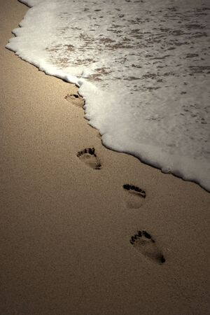 footpath: Footprints on beach sand Stock Photo