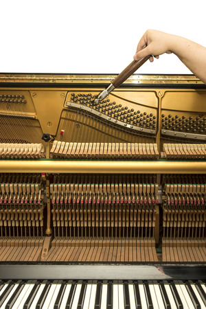 high torque: Tuning an upright piano using lever and tools