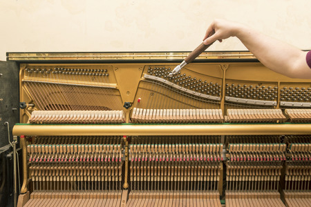 upright piano: Upright piano tuning Stock Photo