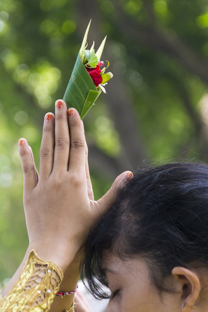 Praying hand at Melasti ceremony  before Balinese New Year Stock Photo