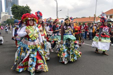 Surabaya, Indonesia - May 7, 2017 : Women wearing recycle dress at annual street parade Surabaya Flower Festival 2017