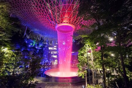 Jewel Changi Airport Rain Vortex, the largest indoor waterfall in the world and the centerpiece of Jewel Changi Airport by night