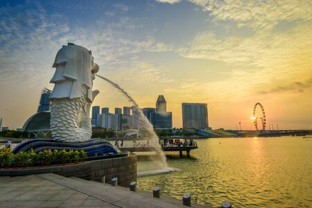 Sunrise at Merlion statue fountain in Merlion Park.