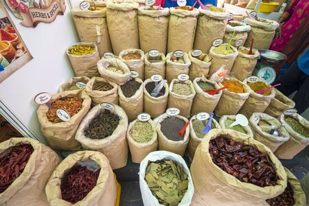 Spices and herbs being sold in Singapore traditional market. Фото со стока - 137757835